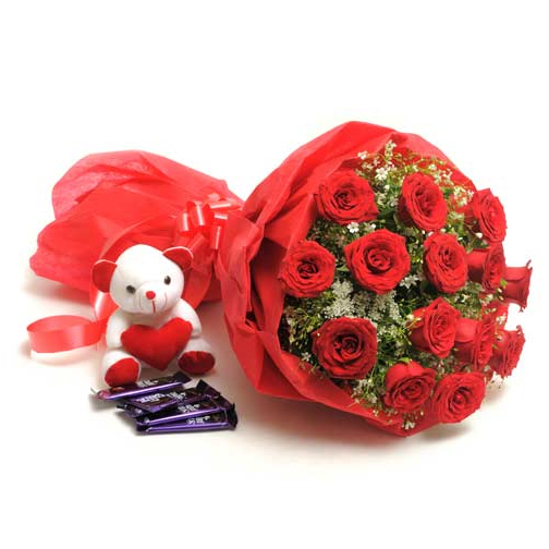 chocolates and cute soft toy to hubli